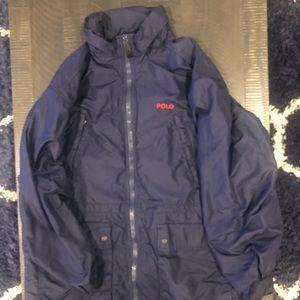 Polo windbreaker jacket with hood.